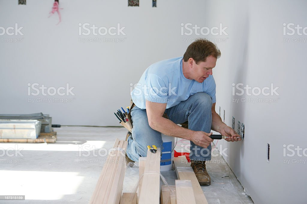 Electrician Installing Outlets royalty-free stock photo