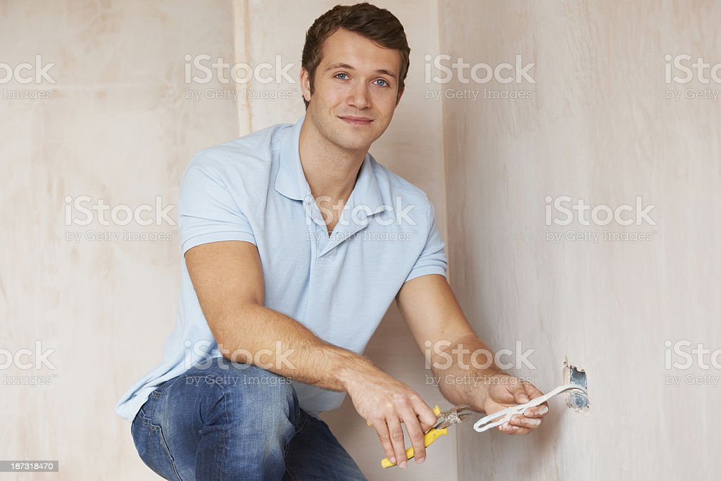 Electrician Installing Socket In New House royalty-free stock photo
