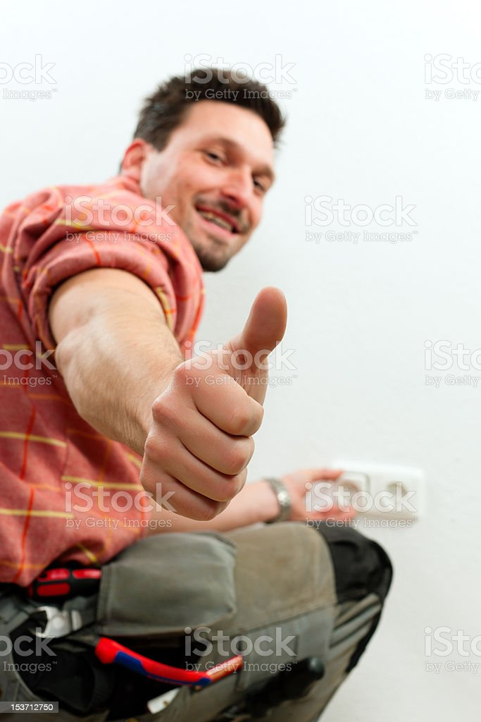 Electrician installing socket royalty-free stock photo
