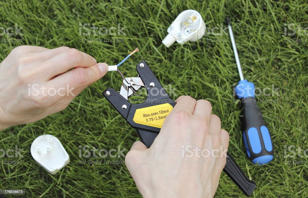Electrician insulating electric wires royalty-free stock photo