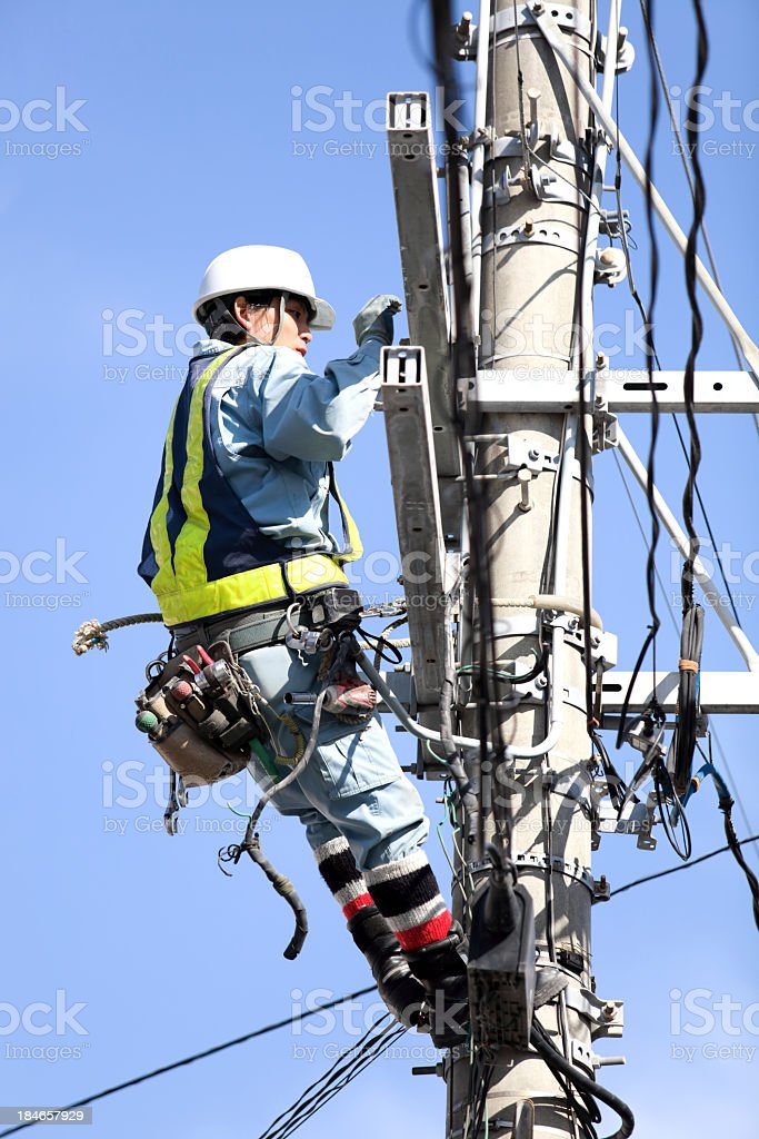Electrician on an electricity pylon stock photo