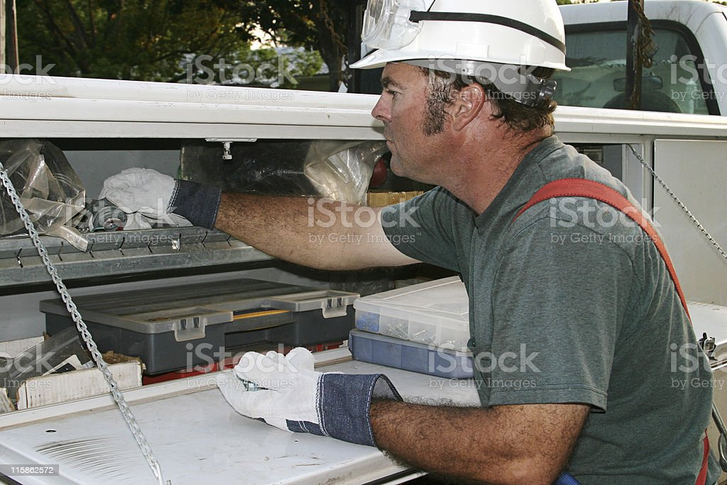 Electrician Reaches In Service Truck royalty-free stock photo