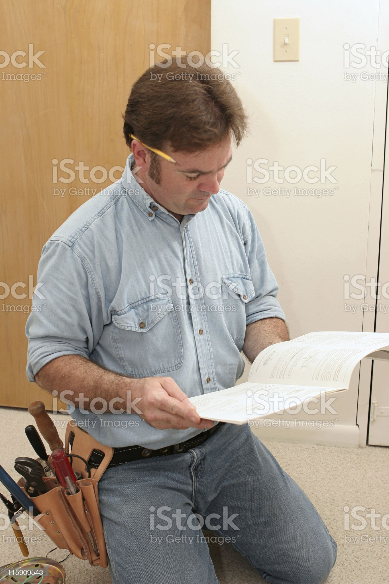 Electrician Reads the Manual royalty-free stock photo
