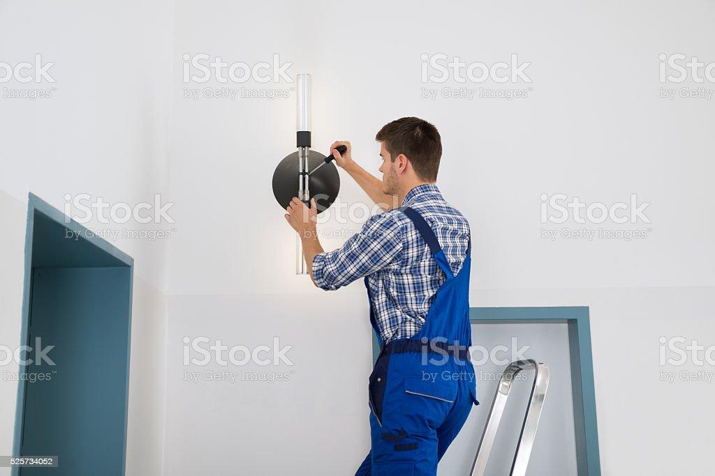 Electrician Repairing Light stock photo