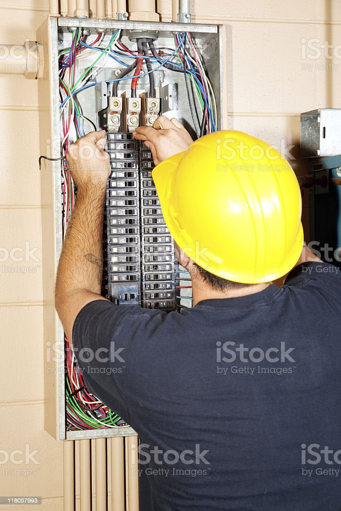 Electrician Replaces Breaker stock photo