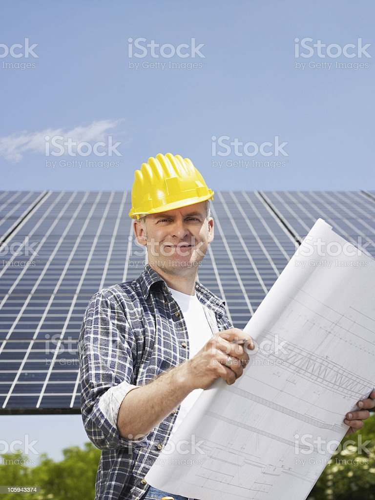 electrician standing near solar panels royalty-free stock photo