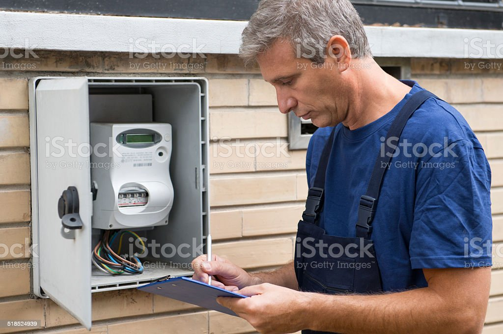 Electrician Taking Meter Readings stock photo