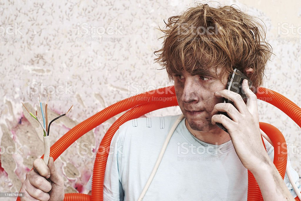 Electrician talking on the phone seeking for help royalty-free stock photo