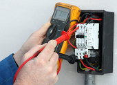 Electrician testing a control circuit.