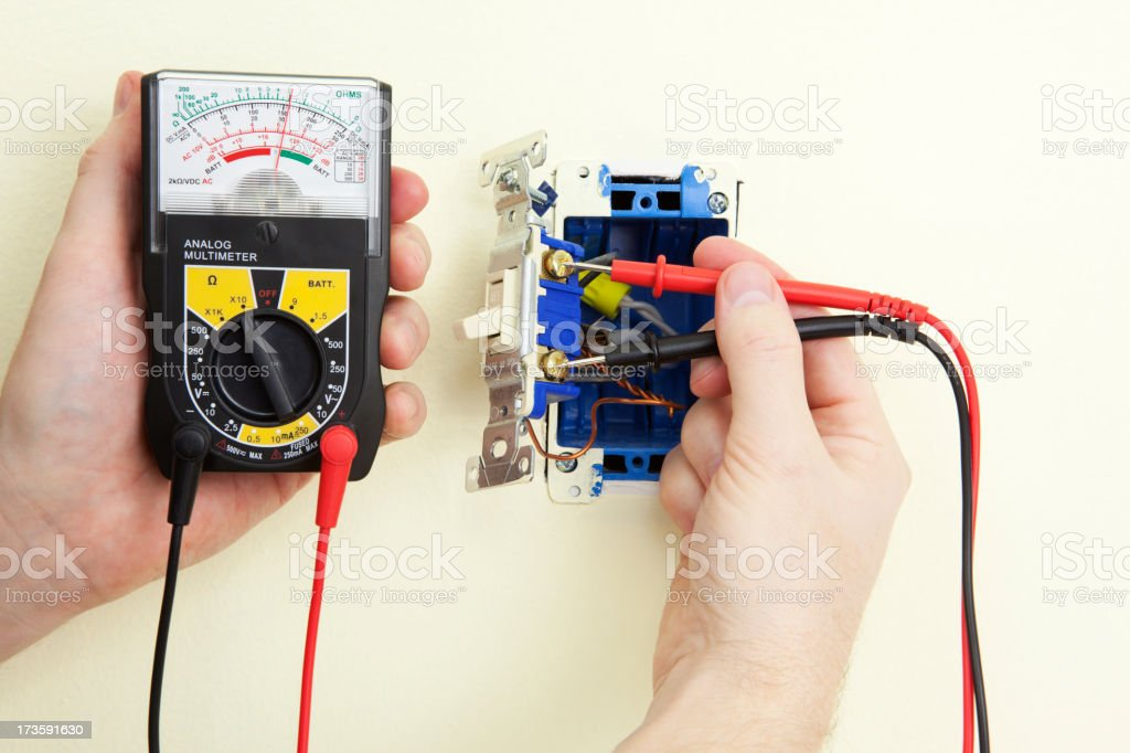 Electrician Testing A Light Switch stock photo