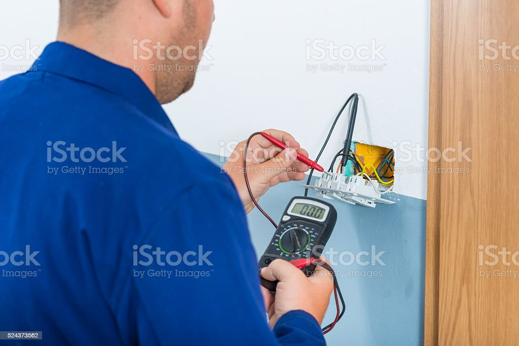 Electrician Testing Voltage stock photo