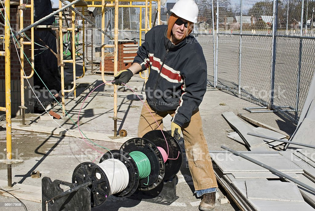 Electrician Unwinding Wire stock photo