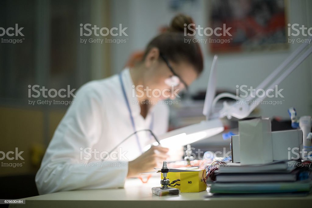 Electrician using magnifying glass stock photo