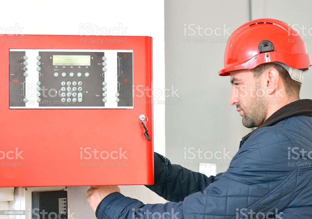 Electrician Wearing Hard Hat at Job Site stock photo