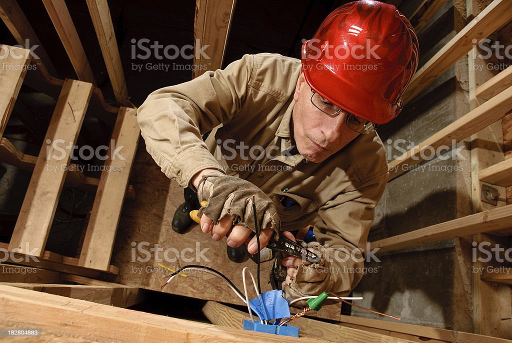 Electrician wiring junction box stock photo