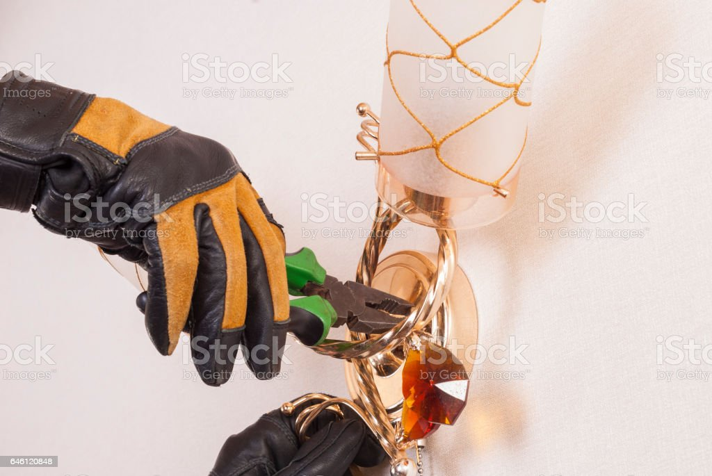 electrician with pliers stock photo