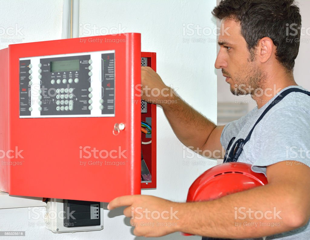 Electrician with Protective Workwear and Hard Hat at Work stock photo