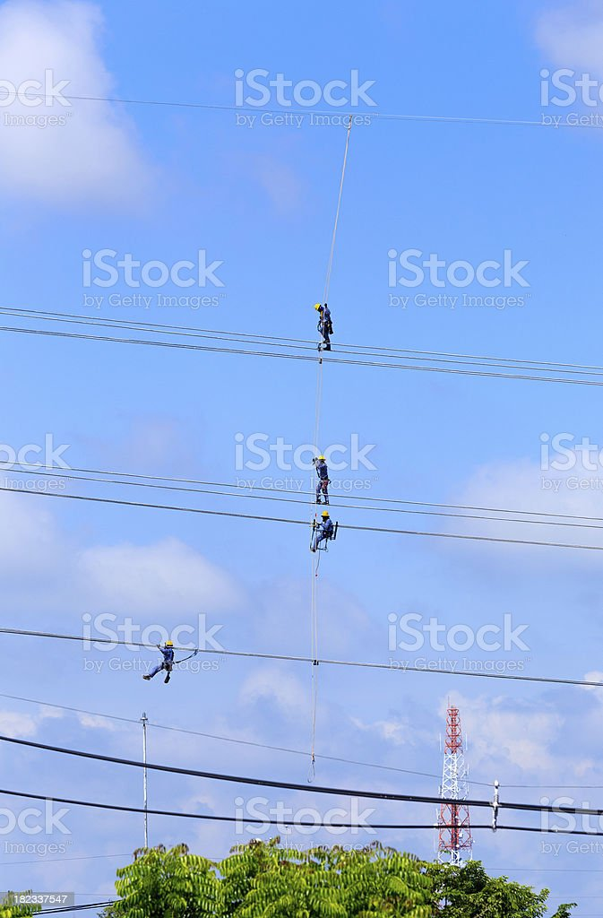 electrician worker at climbing work on high voltage post royalty-free stock photo