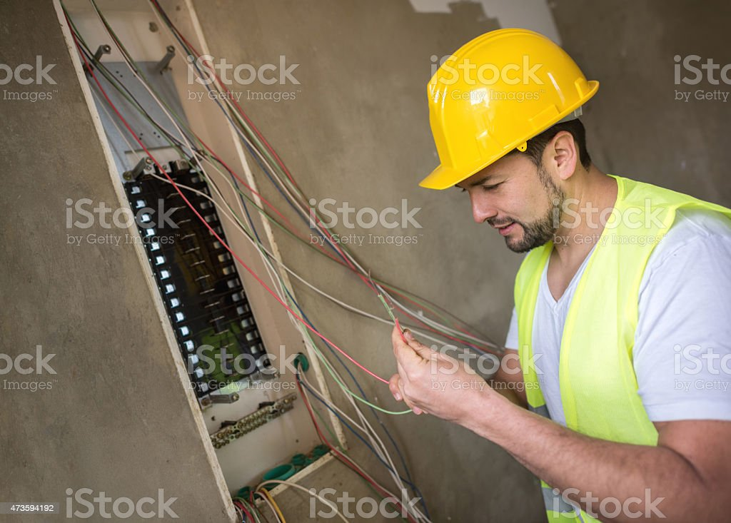 Electrician working at a construction site stock photo