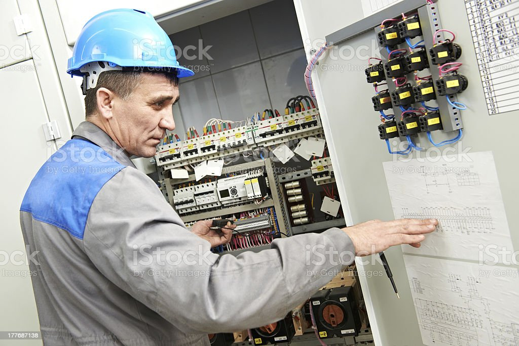 Electrician working at power line box royalty-free stock photo