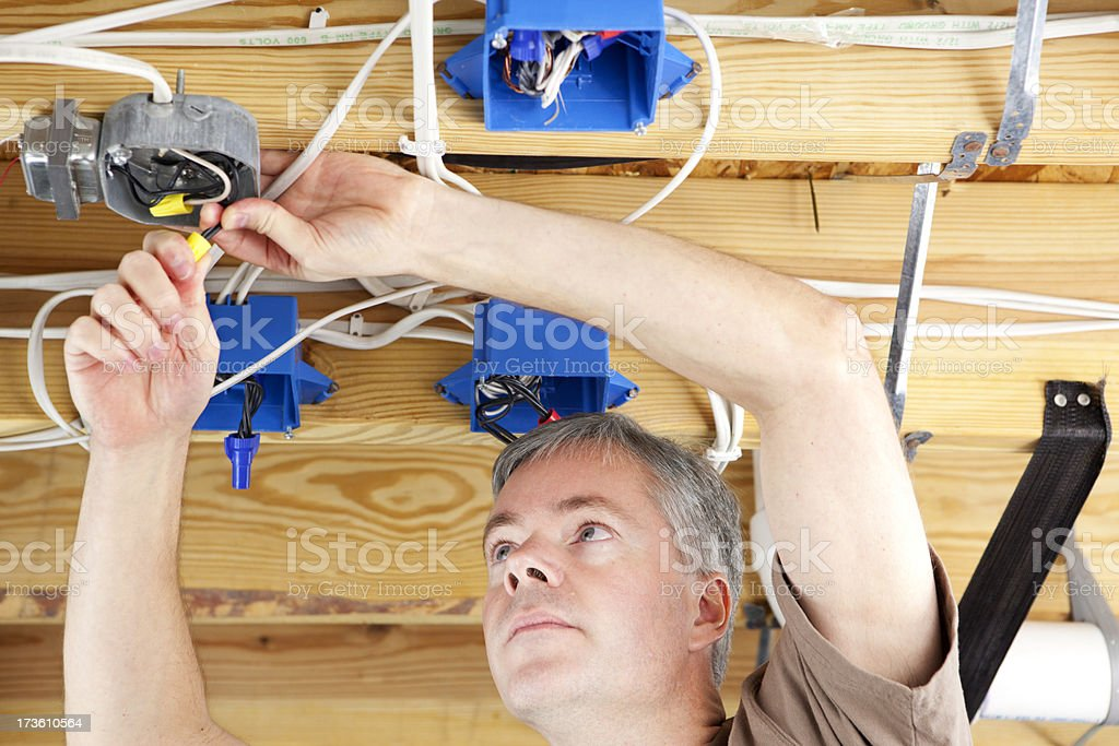 Electrician Working in a Basement stock photo