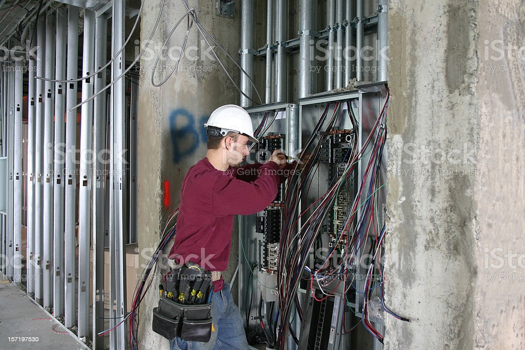 Electrician working in an Electrical Panel. stock photo