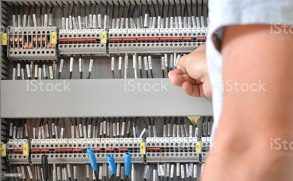 Electrician Working in Electric Room stock photo