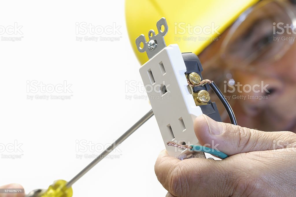 Electrician working on a plug stock photo