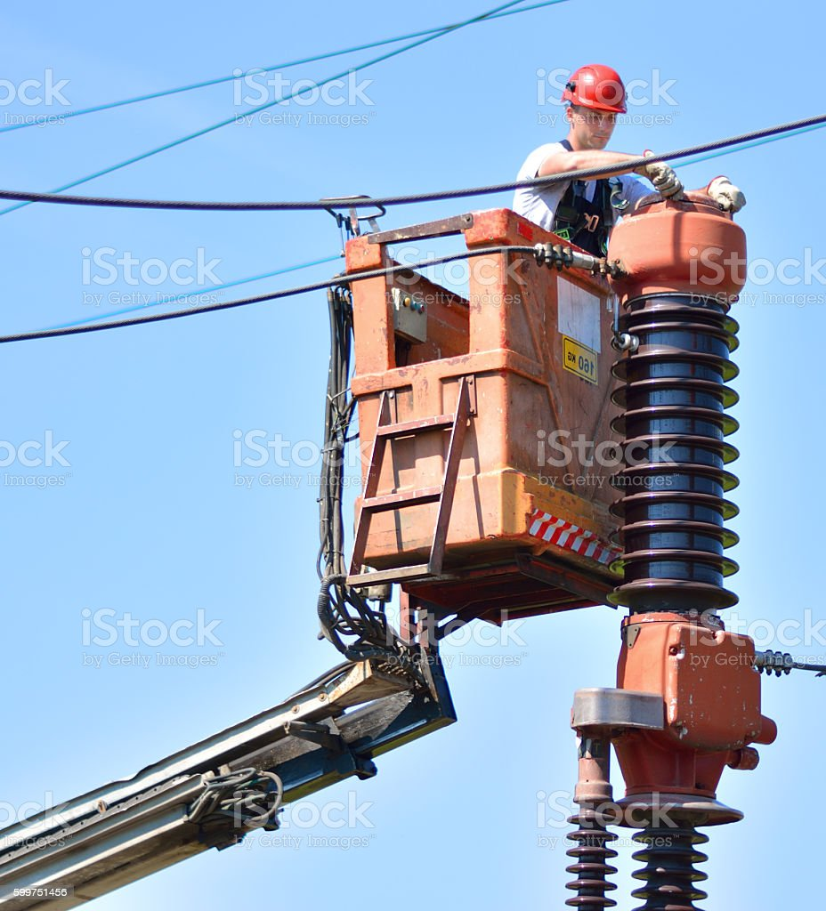 Electrician Working on Circuit Braker in Power Substation stock photo