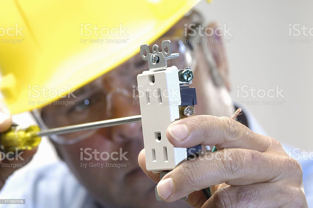electrician working stock photo