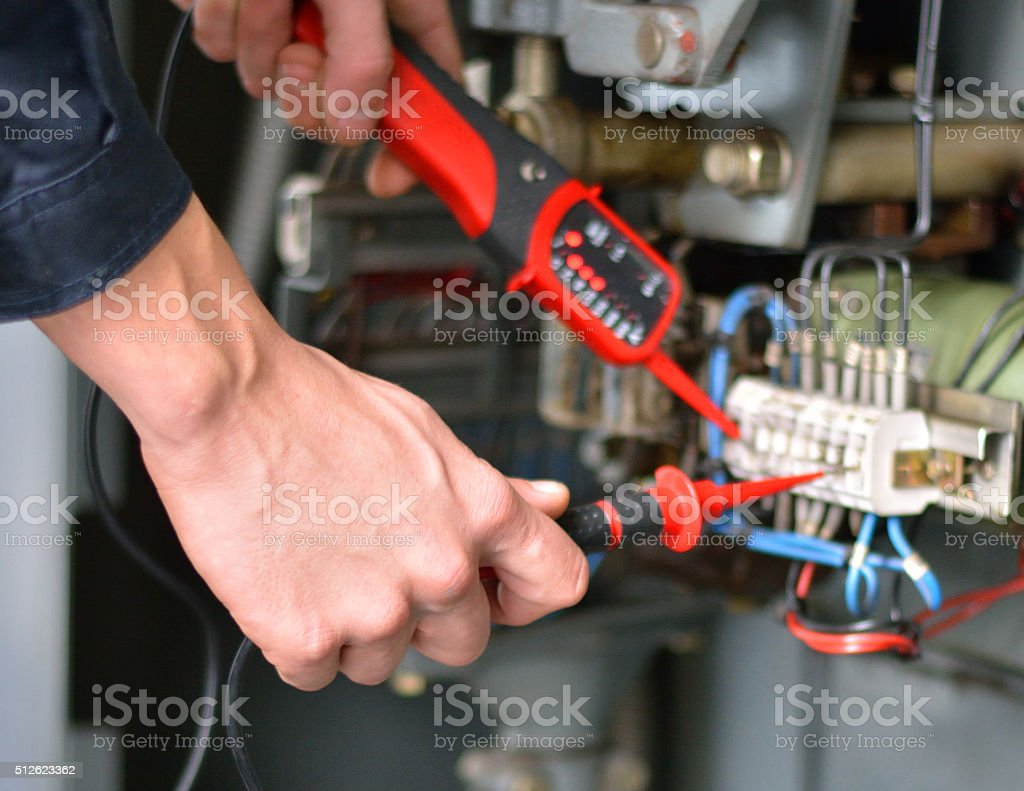Electrician Working with His Instrument of Measurement stock photo