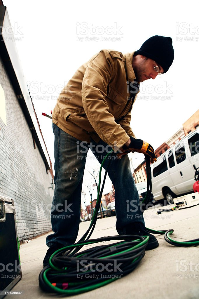 Electrician Wrapping Cable stock photo