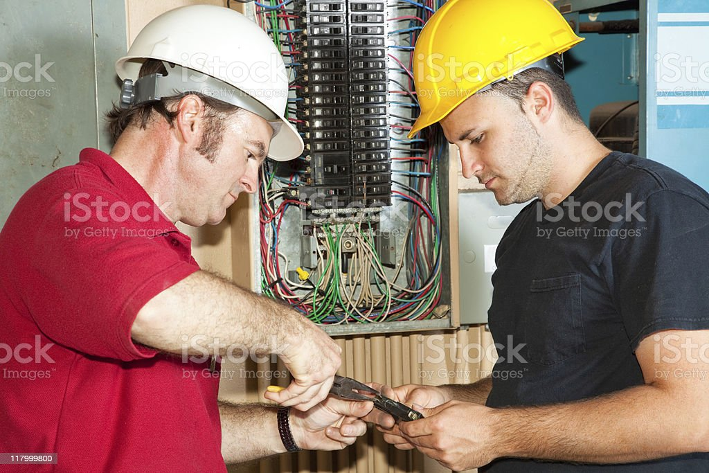 Electricians Repair Circuit Breaker royalty-free stock photo