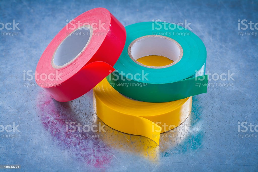 Electricians tapes on scratched metallic background construction stock photo