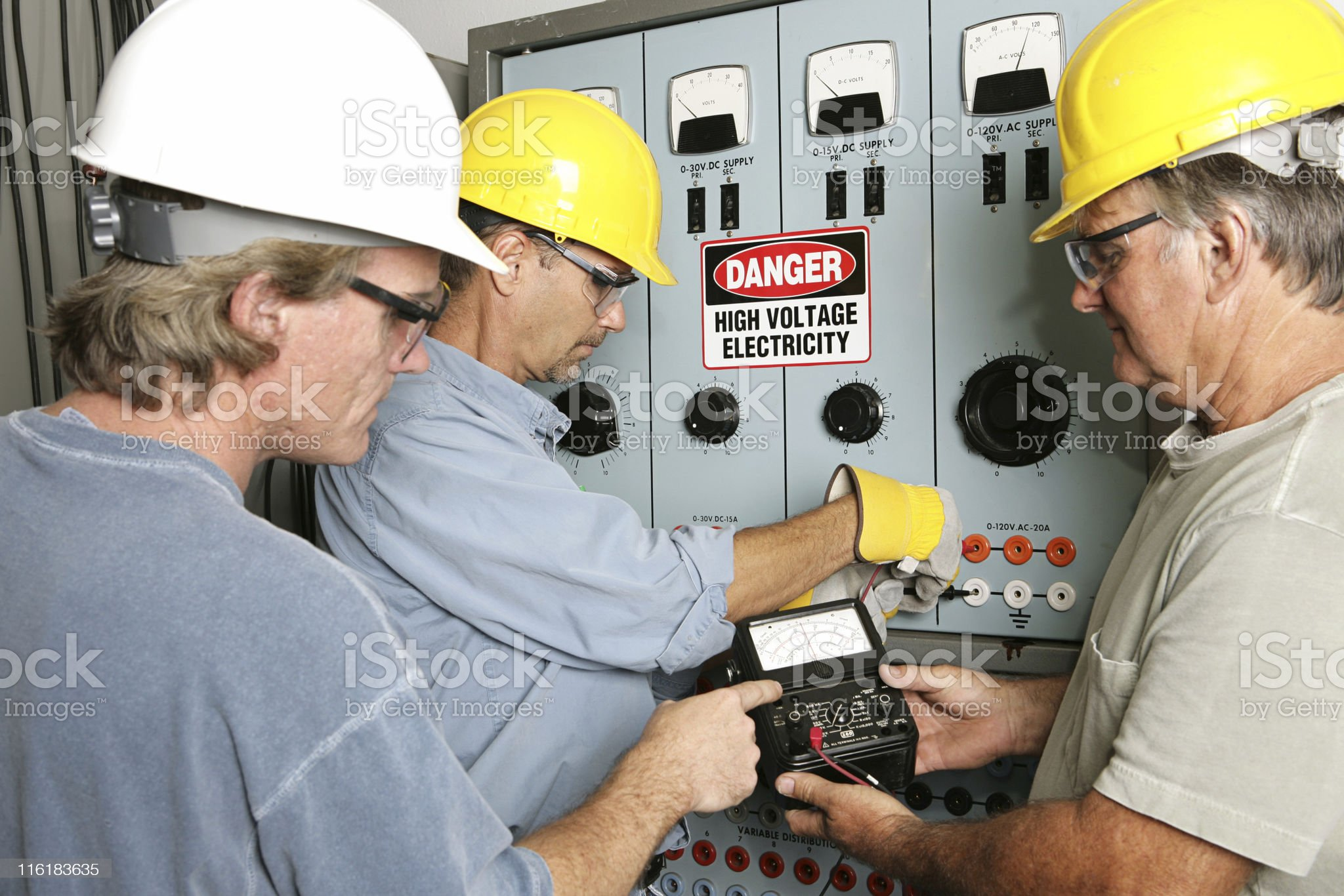 Electricians test voltage at a power center royalty-free stock photo