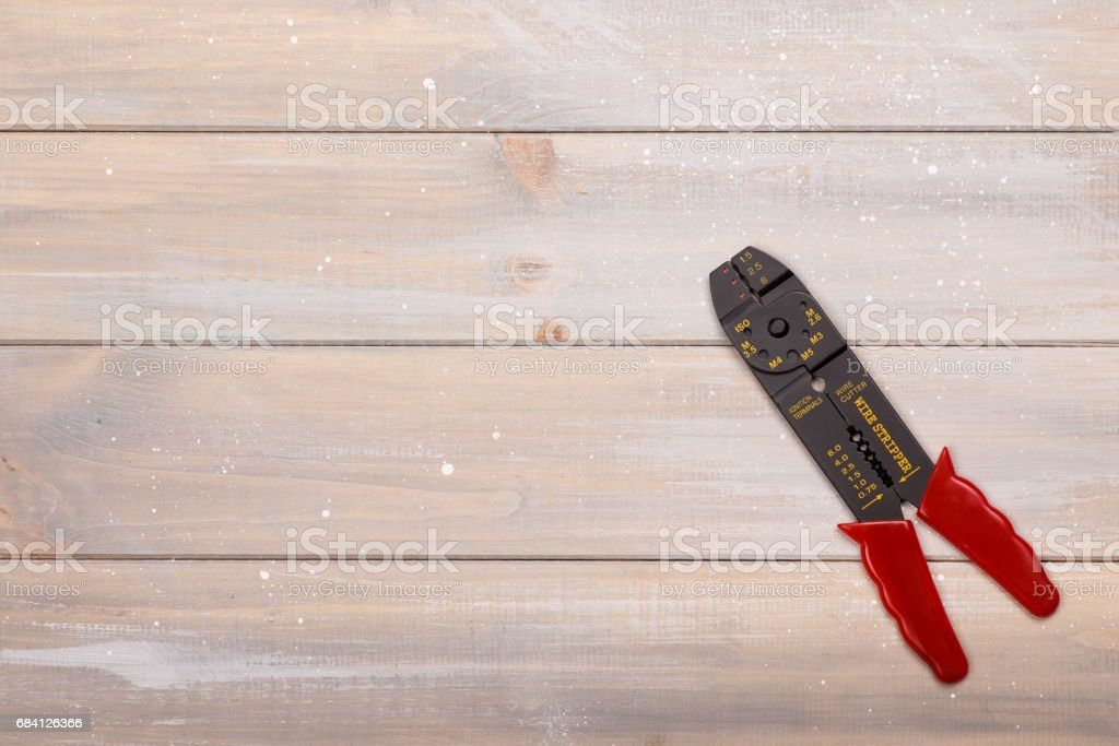Electrician's tool lies on the wooden table stock photo
