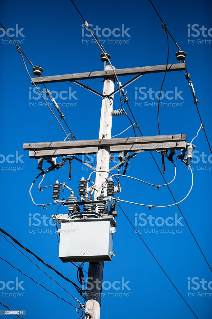 Electricity and telephone pole stock photo