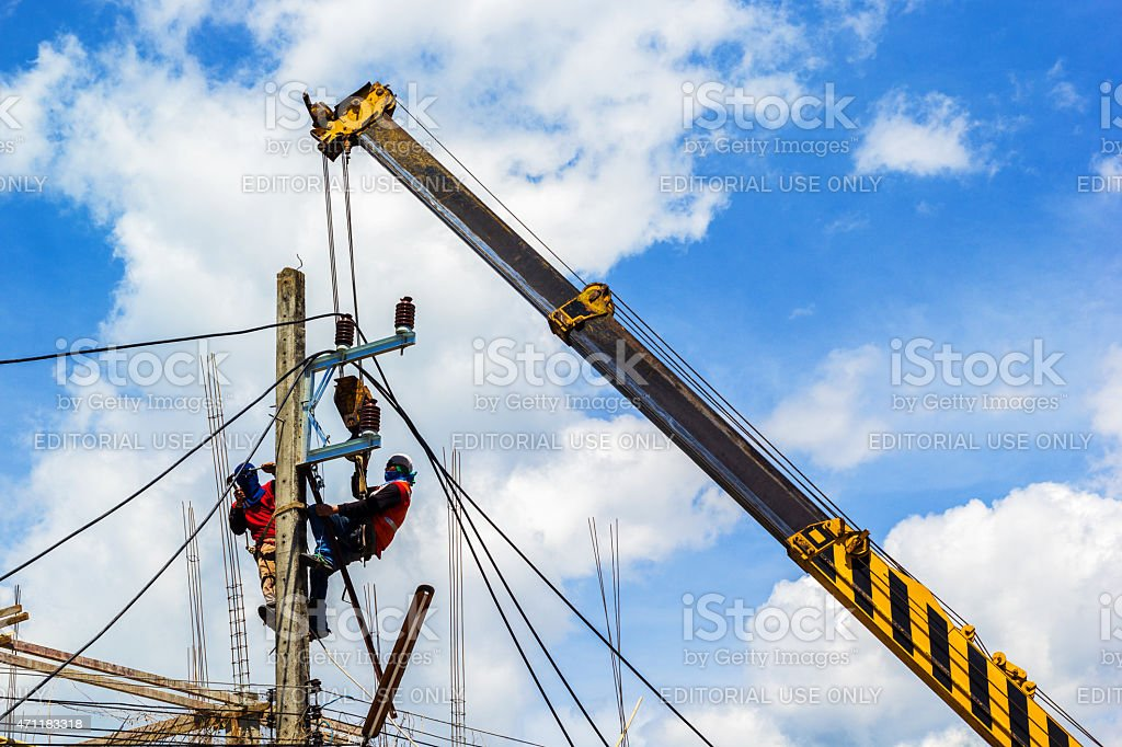Electricity Authority fix and repair a cable stock photo