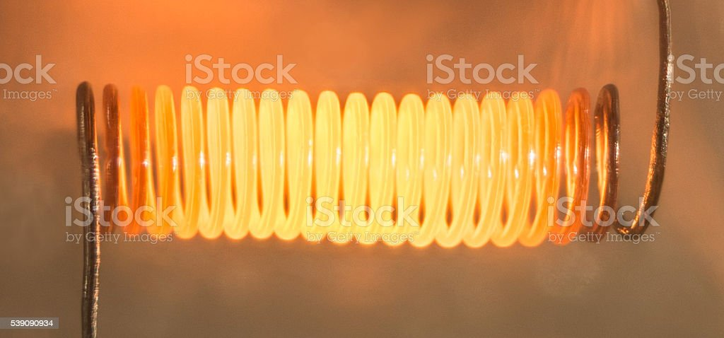 Electricity, burning hot filament conductor. stock photo
