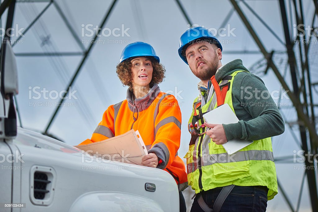 electricity engineers in the field stock photo