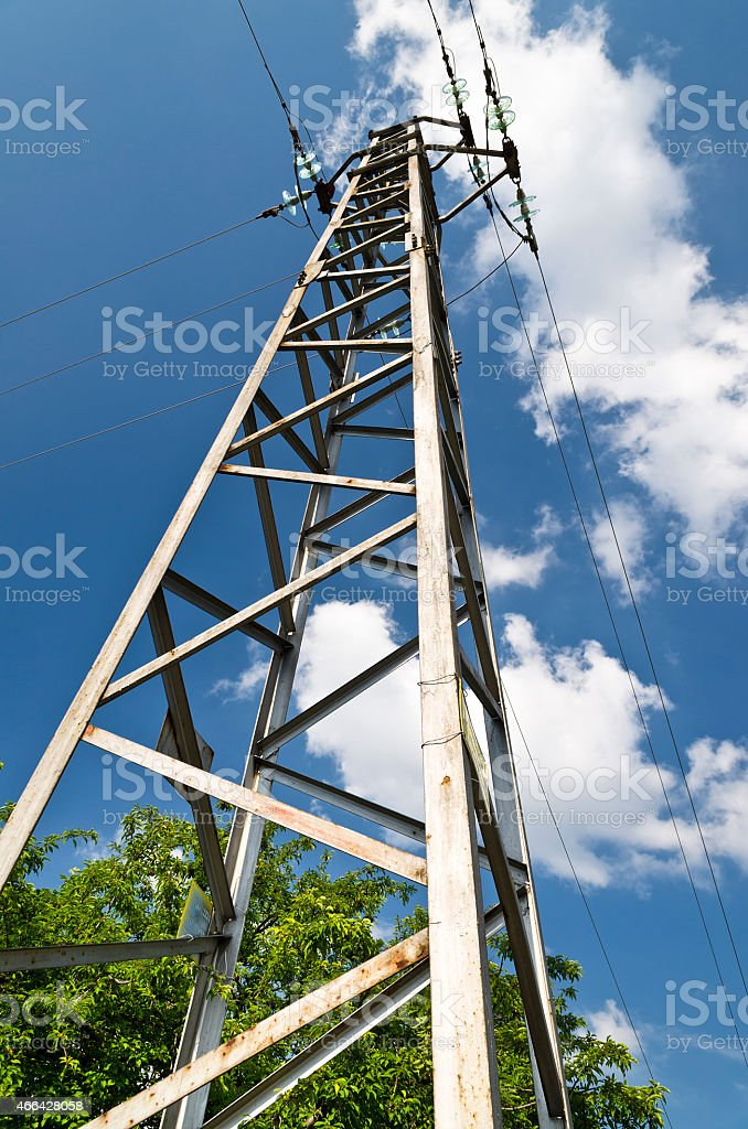 Electricity high voltage pole and the blue and cloudy sky stock photo