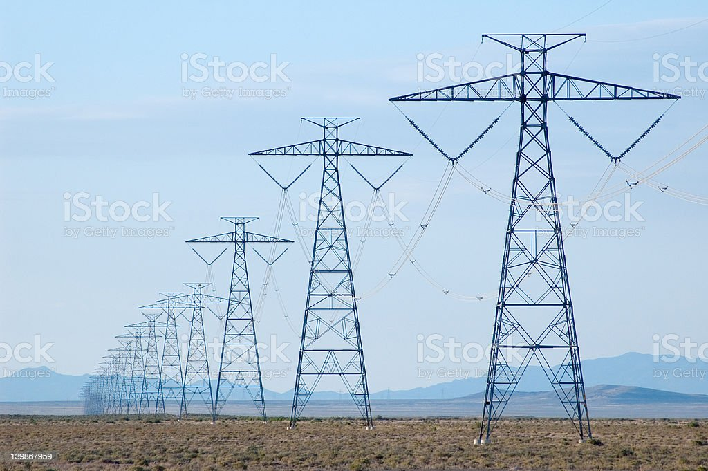 Electricity lines in desert royalty-free stock photo