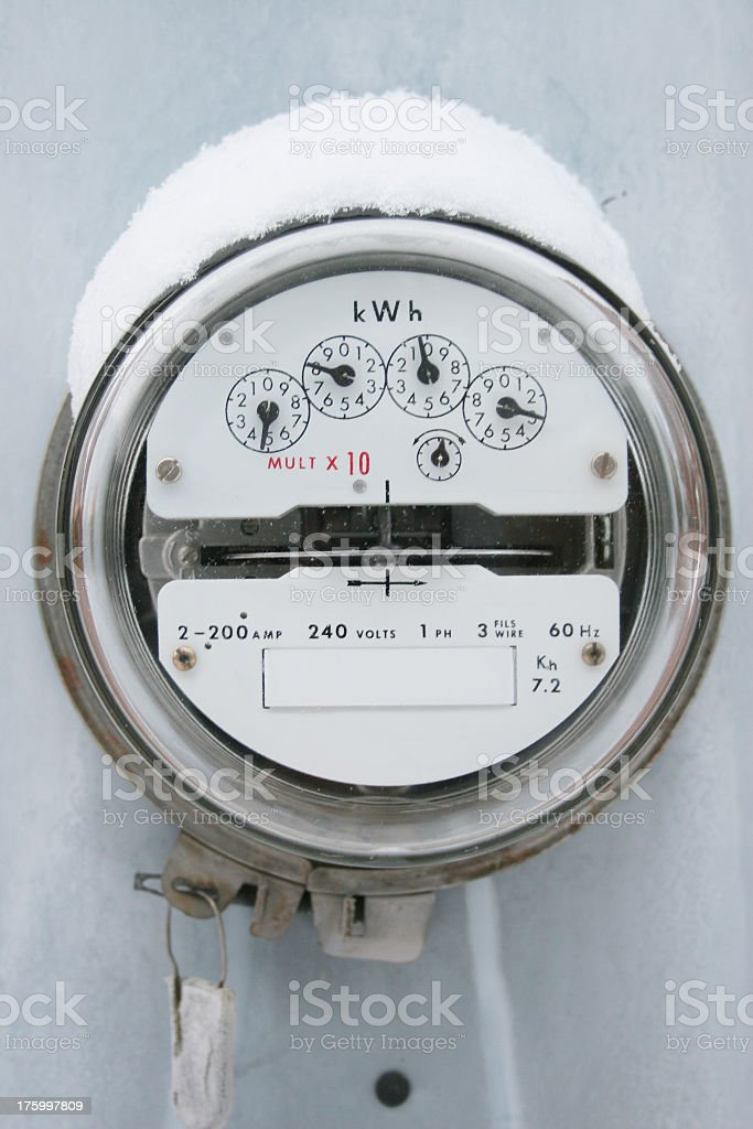 Electricity Meter in the snow storm stock photo