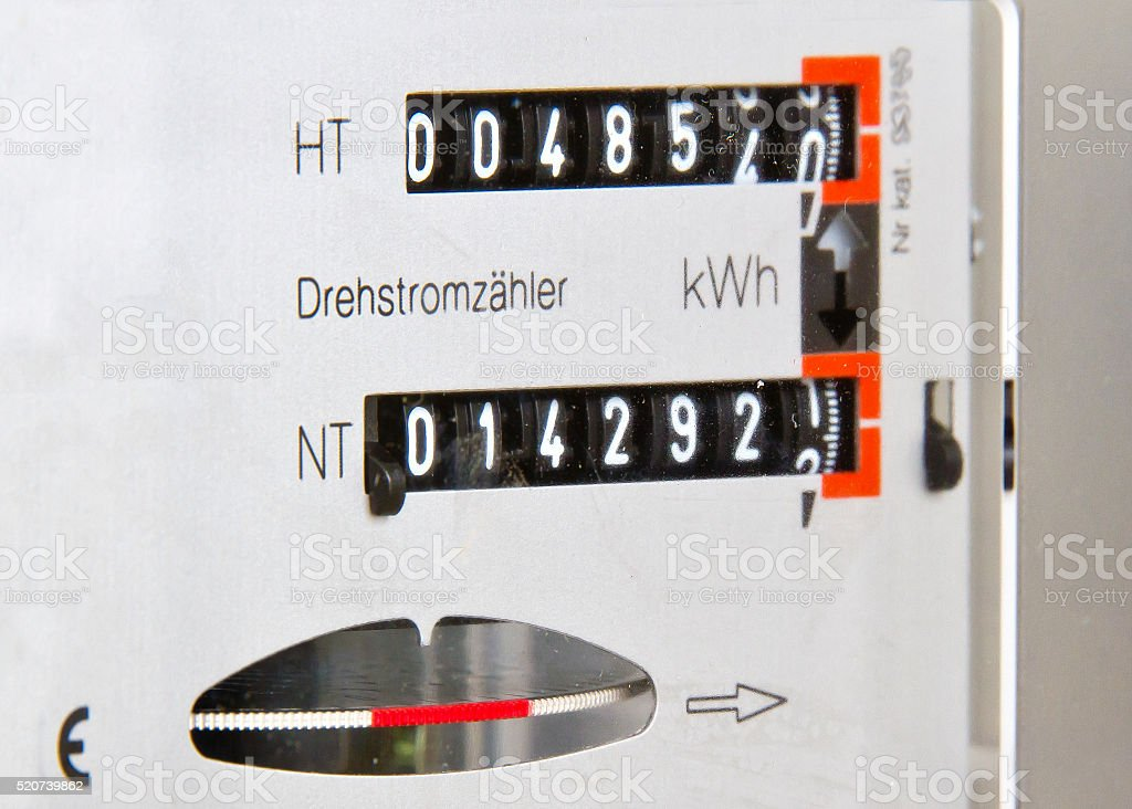 Electricity meter measures stock photo