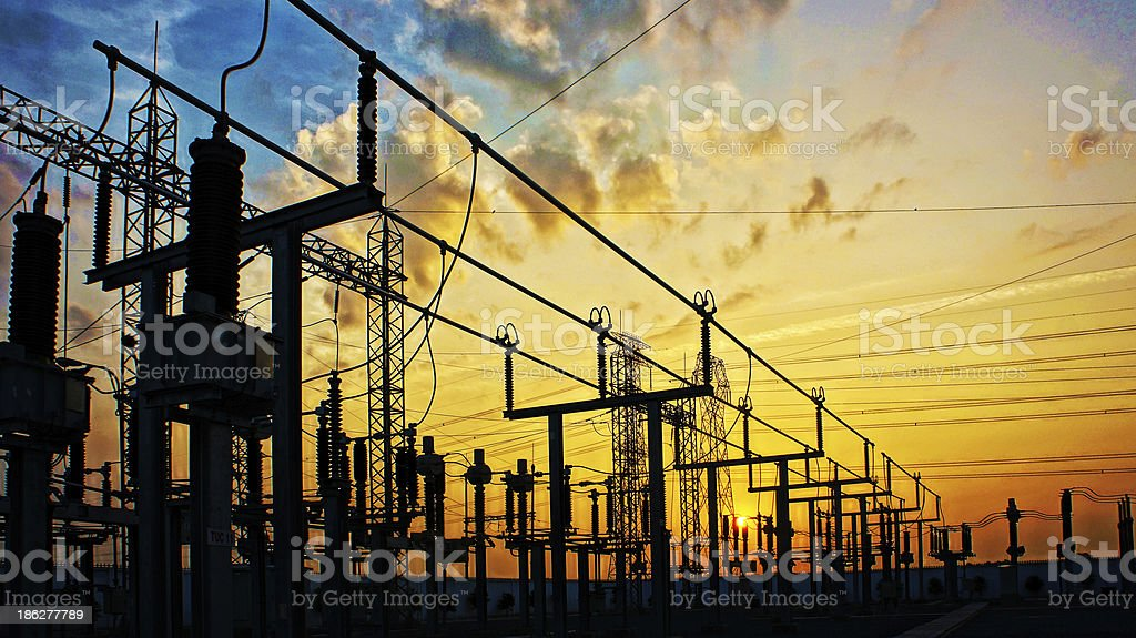 Electricity network at transformer station in sunrise stock photo