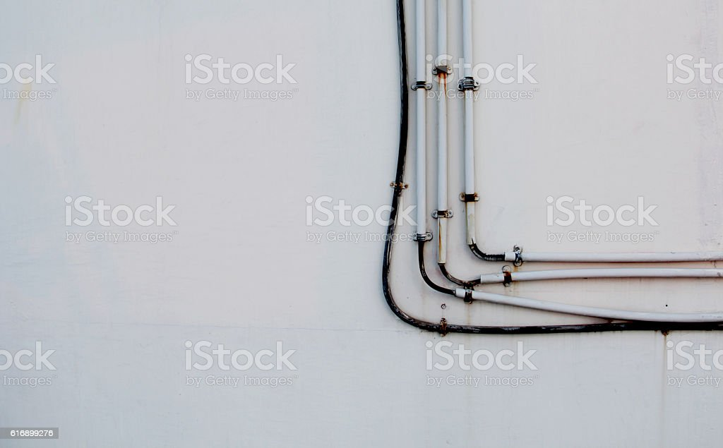 electricity pipes on wall. stock photo
