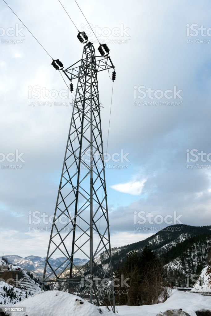 Electricity pole on mountain stock photo