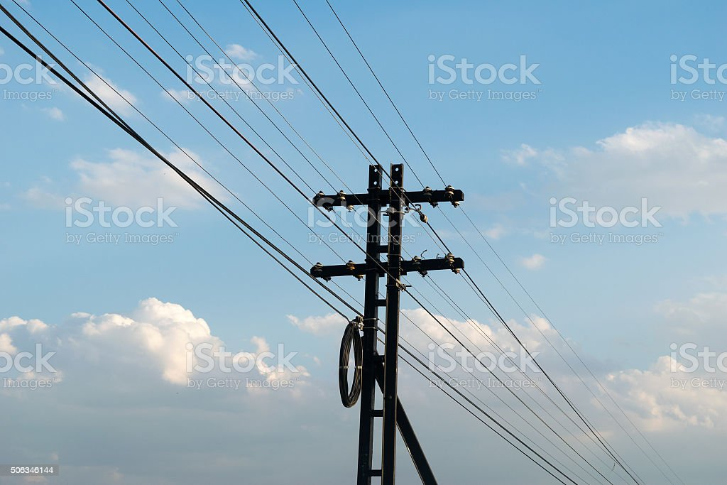 Electricity post and Cable alongside the railway stock photo