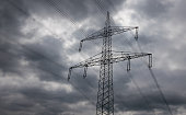 Electricity pylon against the sky in sunlight