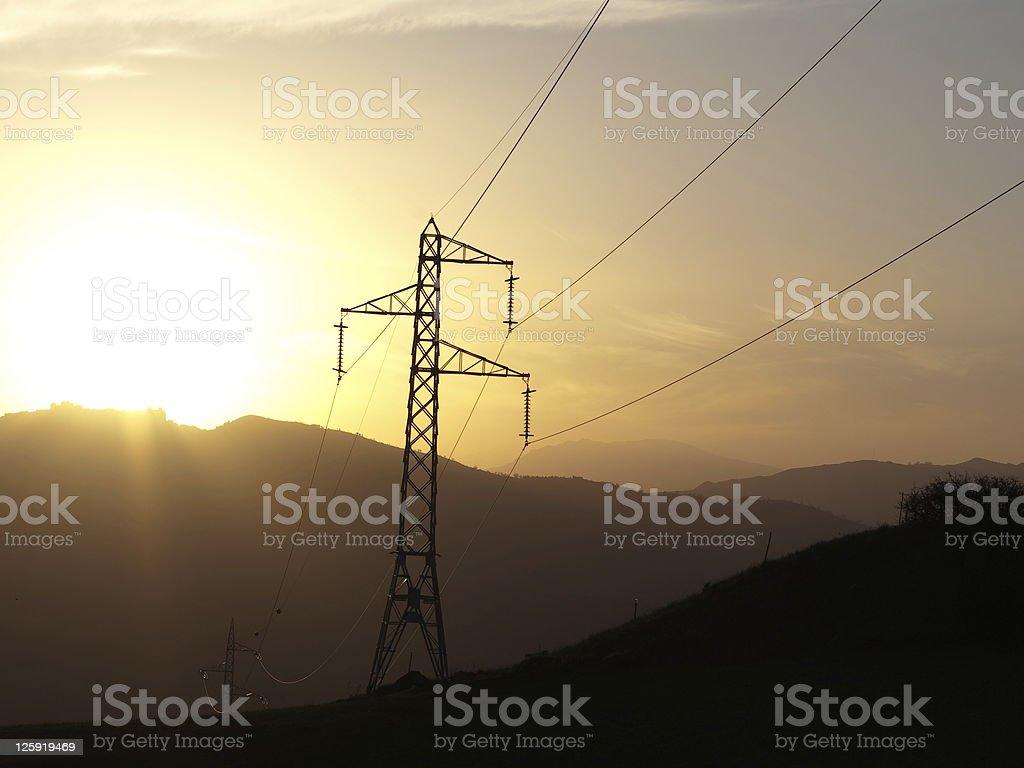 ElectriciTy Pylon At Sunset royalty-free stock photo